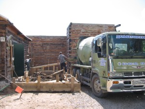 Concrete truck filling up the forms.